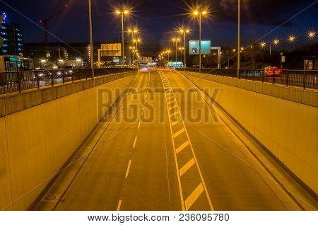Long exposure photo of cars passing through road at night.