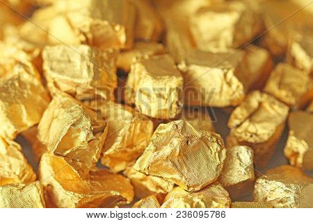 Golden Background. Ingots or Nuggets of Pure Gold. Gold leaf. Tea Resin Puer. poster