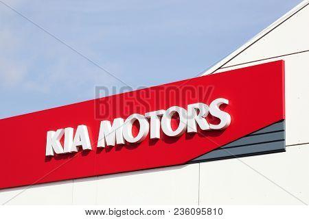 Horsens, Denmark - April 1, 2018: Kia Motors Logo On A Wall Of A Dealership. Kia Motors Corporation