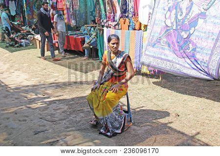 India, Goa, January 24, 2018. Indian Woman Saleswoman In The Anjuna Market, Goa, India. Indian Marke