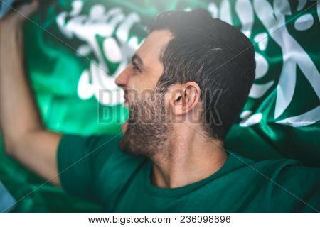 Saudi Arabia fan celebrating with flag