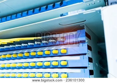 fiber optic telecommunication equipment and patchcords inside a network infrastructure