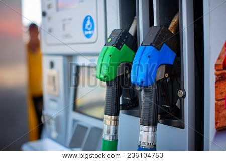 Colorful Petrol Pump Filling Nozzles Isolated On White Background , Gas Station In A Service In Warm