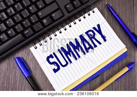 Word writing text Summary. Business concept for Brief Statement Abstract Synopsis Concise Abbreviated version written Notepad wooden grey background Pens and Black Keyboard next to it. poster