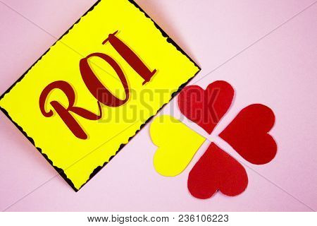 Writing Note Showing  Roi. Business Photo Showcasing Return On Profit Performance Measure Evaluation