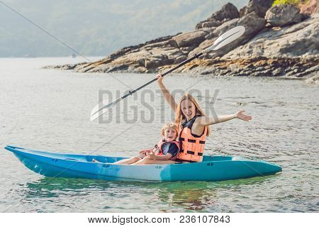 Mother And Son Kayaking At Tropical Ocean. Travel And Activaties With Children Concept.