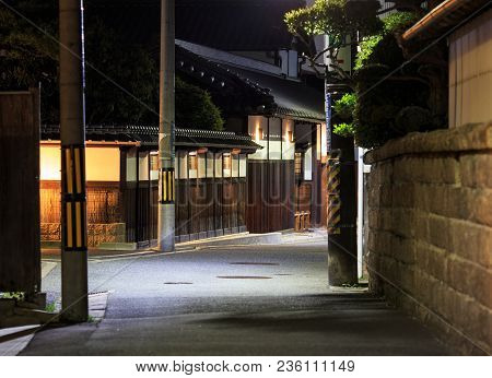 Quiet Street Runs By An Old Wooden House In Osaka, Japan