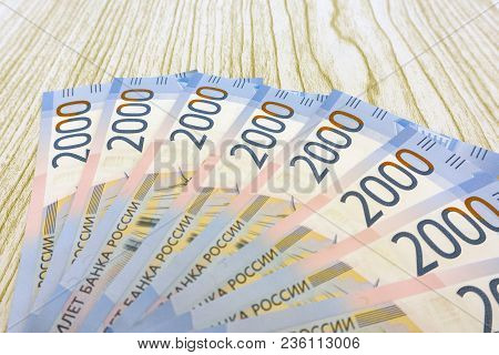 Russian Money Background. New 2000 And 200 Rubles, Old Banknotes In Denominations Of 100, 500, 1000