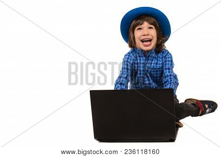 Laughing Elegant Executive Boy With Laptop Looking Up To Copy Space Isolated On White Background