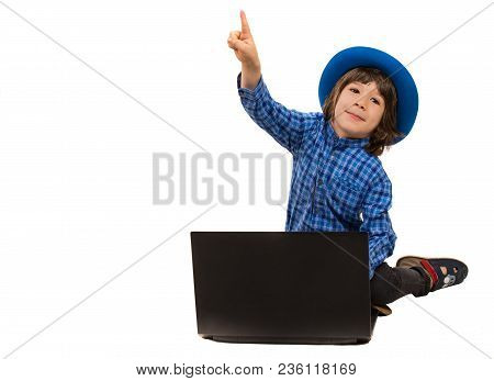 Cute Executive Boy Withlaptop Pointing Up To Copy Space Isolated On White Background