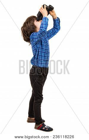 Profile Of Boy Looking Up Through Binoculars Isolated On White Background