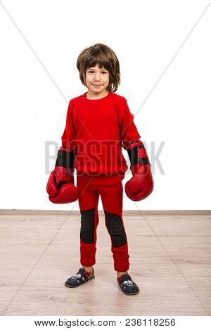 Serious Boy Wearing Boxing Gloves  Against White Background