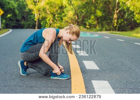 Female Runner Tying Her Shoes Preparing For Jogging Outside .young Girld Runner Getting Ready For Tr