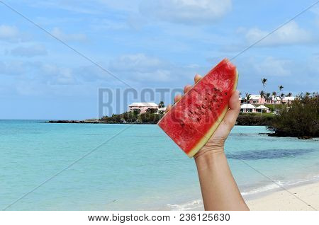 Ripe Juicy Watermelon In The Hands Of The Man Against The Backdrop Of Tropical Islands And The Sea,w