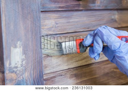 He Is Painting The Door. A Man Paints A Surface. Brush The Door With A Brush. A Woman Is Painting A