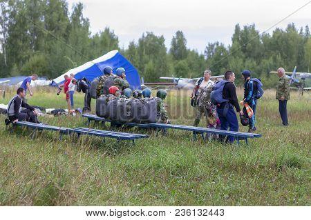 Russia, Moscow, August 14, 2016, Men Preparing For A Parachute Jump, Editorial