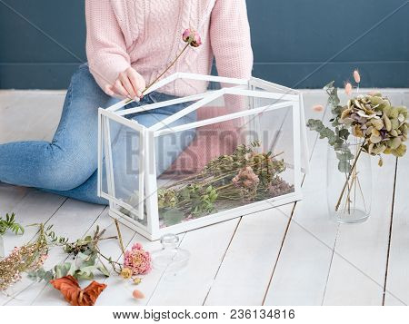 Hobby And Leisure Concept. Woman Ccreating A Unique Flower Arrangement In A Glass Box To Decorate He