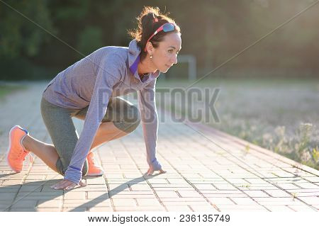 Sprinter Girl Start Position On The Track. Jogging Sport