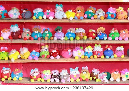 Many Animal Dolls In Many Colors, Placed On A 4 Layer Shelves.