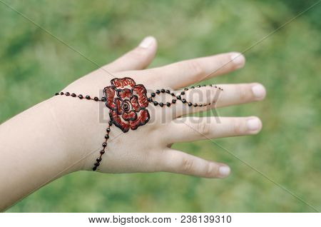 Artist Applying Henna Tattoo On Women Hand