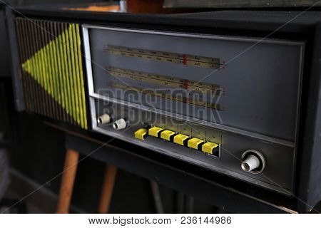 Old Radio With Yellow Buttons On Wooden Legs. Nostalgia. Old Times. Road To The Past.