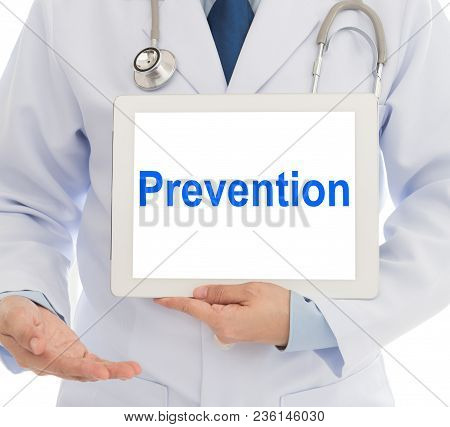 Health Prevention Concept. Doctor With Digital Tablet Computer Showing Prevention Words At Hospital.