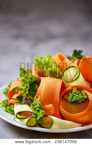 Artistically Served Vegetable Salad With Carrot, Cucumber, Letucce On White Plate Over White Texture