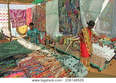 India, Goa, January 24, 2018. Indian Market In The Village Of Anjuna. Bright Goods And Paints Of Ind