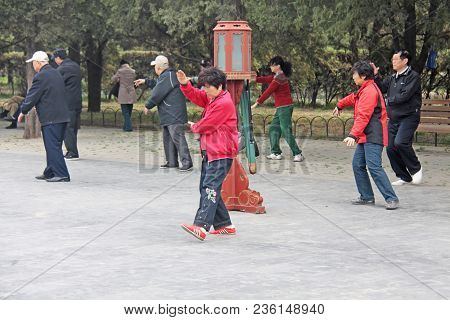 China, Beijing - April 10, 2012. Qigong In China. Qigong In The Park Temple Of The Sky.