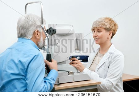 Ophtalmological Specialist Treating Old Patient's Vision.