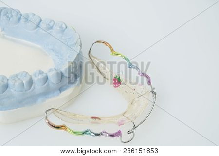 Dental  Retainer Orthodontic Appliance On The White Background.