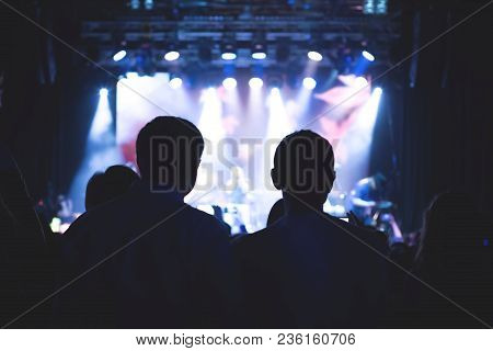 The Audience Watching The Concert On Stage In Big Concert Club.