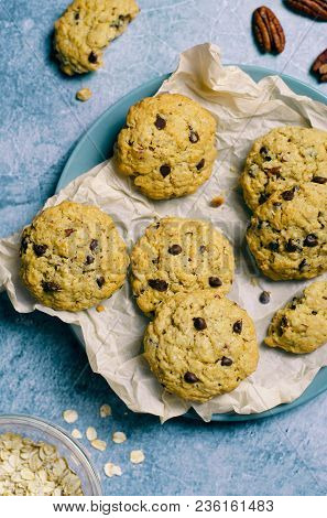 Freshly Baked Oatmeal Chocolate Chip Cookies On Blue Background