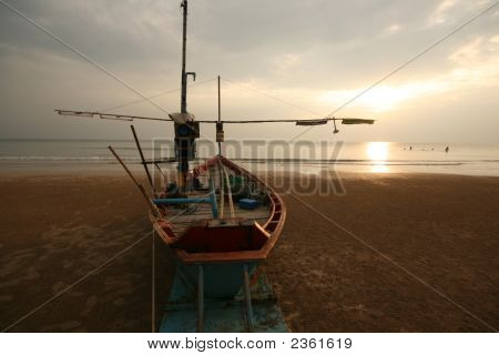 Boat On Sunset Beach