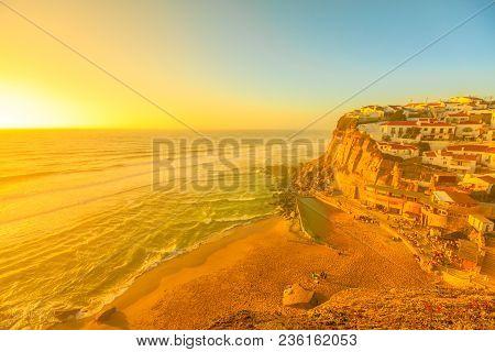 Scenic Promontory At Sunset Light Of Azenhas Do Mar On Atlantic Ocean, A Popular Portuguese Seaside