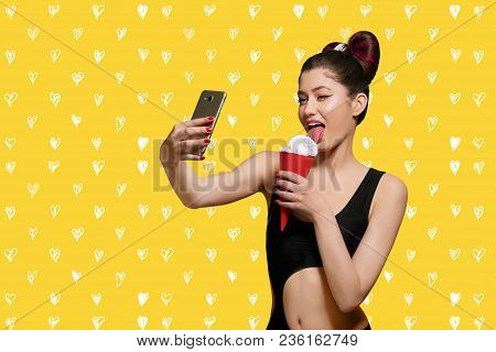 Pop Art Model Eating Ice Cream, Taking Selfie. Girl Wearing Original Fashionable Hairstyle And Brigh