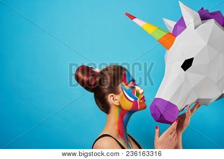Sideview Of Pop Art Portrait Of Model Wearing Colorful Figures On Her Face.