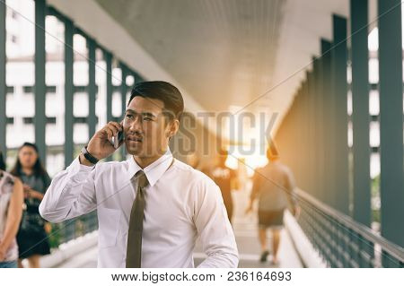 Businessman Talking On The Phone With Stressed About The Job.