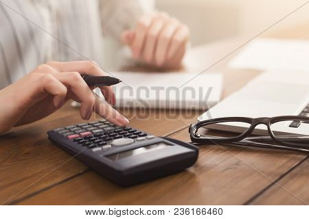 Closeup Of Woman Hands Counting On Calculator And Writing In Documents. Financial Background, Count