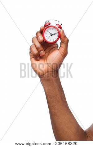 Black Male Hand Holding Red Miniature Alarm Clock, Isolated On White Background. Sleep, Time Managme