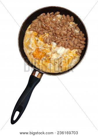 Refried Beans And Scrambled Eggs In A Frying Pan On Isolated Background.