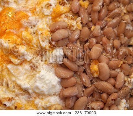 Large Pink Fried Beans And Scrambled Eggs Closeup