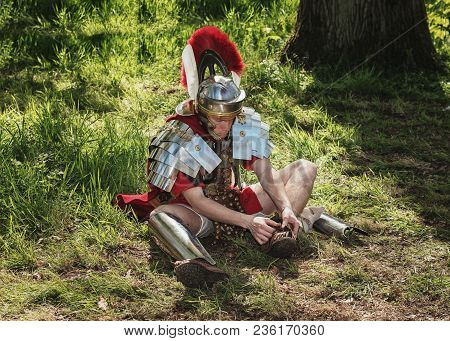 April, 19, 2014, Haarzuilens, The Netherlands: Roman Centurion Put On His Sandals During The Elf Fan