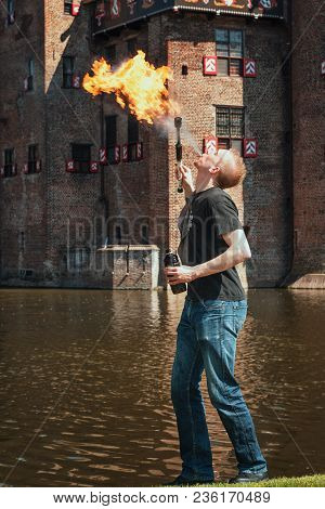April, 19, 2014, Haarzuilens, The Netherlands: Fire Spitter At Work On The Edge Of The Moat During T