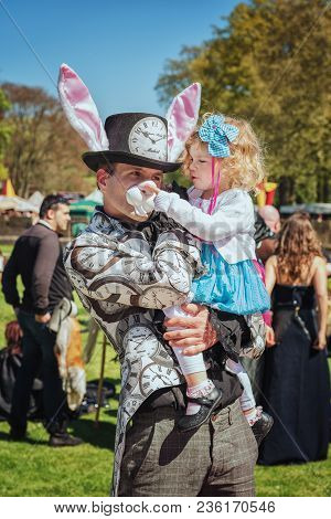 April  19, 2014, Haarzuilens, The Netherlands: Little Girl In The Arms Of Dad Enjoys The Elf Fantasy