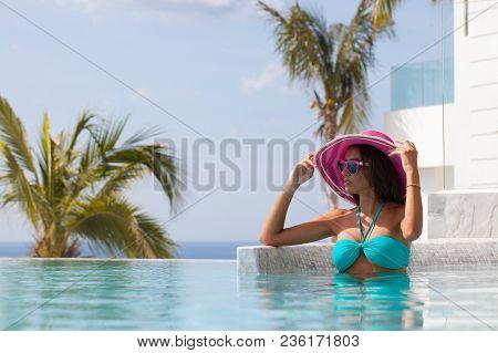 Girl Resting At Infinity Pool