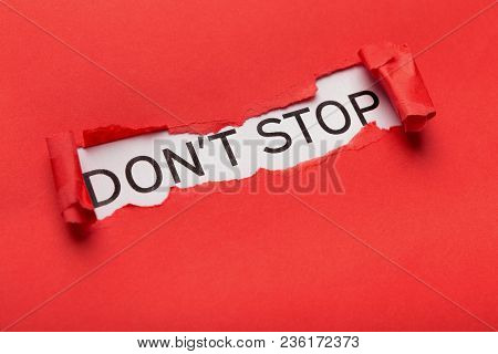 Motivational Poster With Dont Spot Phrase Appearing Behind Torn Red Paper. Inspiration And Support C