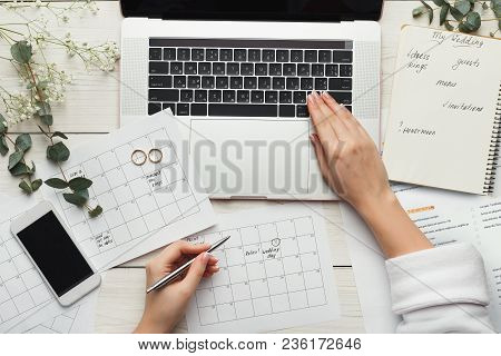 Wedding Arrangement Background. Female Hands Preparing For Marriage, Using Laptop, Smartphone, Paper