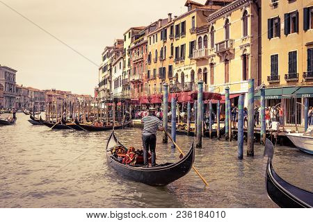Venice, Italy - May 21, 2017: Gondolas With Tourists Float Along The Grand Canal In Venice. Gondola