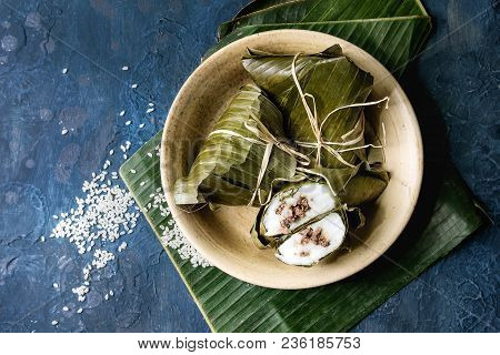 Asian Rice Piramidal Steamed Dumplings From Rice Tapioca Flour With Meat Filling In Banana Leaves Se